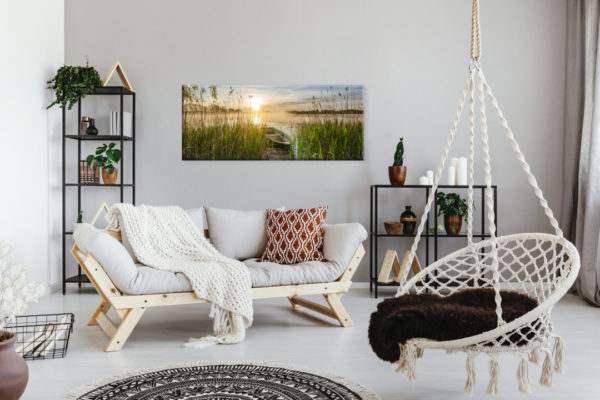 Glasbild Boot im Schilf – Panorama im Wohnzimmer