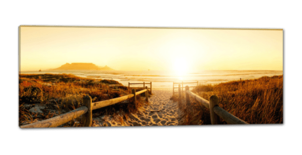 Glasbild Sonnenuntergang am Strand