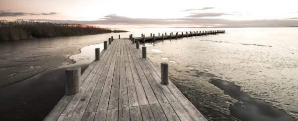 Glasbild Steg am See