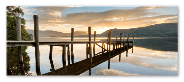 Glasbild Sonnenuntergang am See