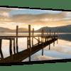 Glasbild Sonnenuntergang am See Ansicht schräg