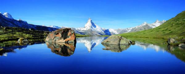 Glasbild See und Berge